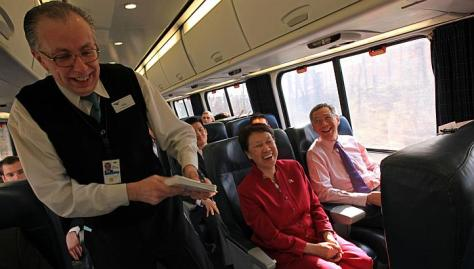 Prime Minister Lee Hsien Loong, with his wife Ho Ching, sharing a light moment with train lead service attendant John Laliberte, 57, on being a fellow left-hander after Mr Laliberte took his meal order. They were travelling on the regular Acela Express from Washington, DC to New York City on Wednesday. -- ST PHOTO: WANG HUI FEN